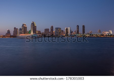 Scenic San Diego Bay and tall buildings downtown. Harbor boats with motion blur - stock photo