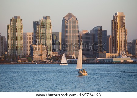 Scenic San Diego skyline, sailboat and waterfront, Pacific Ocean at sunset, California  - stock photo