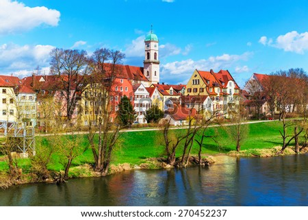 Scenic spring view of old buildings at Danube river pier and street architecture in the Old Town of Regensburg, Bavaria, Germany - stock photo