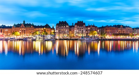 Scenic summer evening panorama of the Old Town (Gamla Stan) architecture pier in Stockholm, Sweden - stock photo