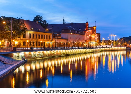 Scenic summer night view of the Old Town illuminated pier architecture in Wroclaw, Poland - stock photo