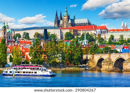 Scenic summer panorama of the Old Town architecture with Vltava river, Charles Bridge and St.Vitus Cathedral in Prague, Czech Republic - stock photo