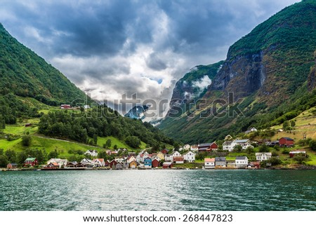 Scenic summer panorama of the Old Town pier architecture of Bryggen in Bergen, Norway - stock photo