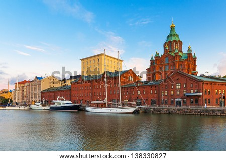 Scenic summer panorama of the Old Town with Uuspenski orthodox cathedral church and old port in Katajanokka district in Helsinki, Finland - stock photo