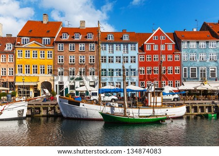 Scenic summer view of color buildings of Nyhavn in Copehnagen, Denmark - stock photo