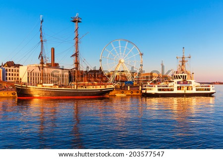 Scenic sunset panorama of the Old Town pier in Helsinki, Finland - stock photo