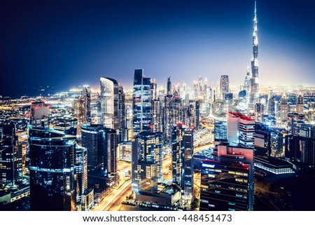 Scenic top view of a big modern city at night. Business bay, Dubai, United Arab Emirates.  - stock photo