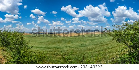 Scenic Tuscany landscape with rolling hills and traditional farm house in Val d'Orcia, Italy - stock photo