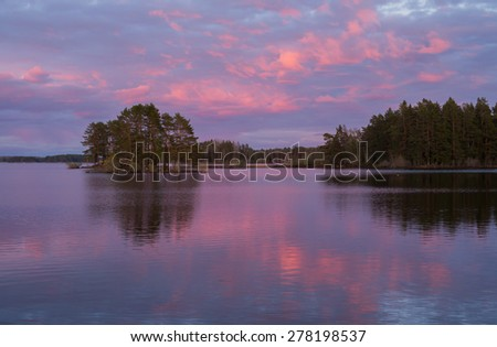 Scenic view of a calm lake in sunset - stock photo