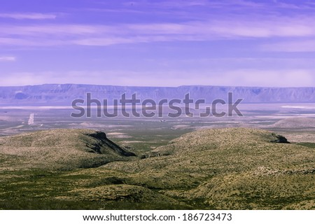 scenic view of a farmland beside  Guadalupe Mountains National Parks,  Texas, USA - stock photo