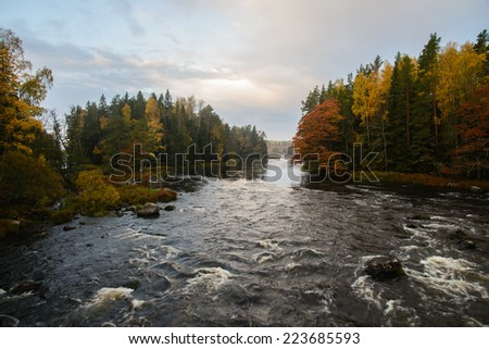 Scenic view of a  river in autumn before the sunrise - stock photo