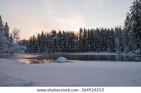 Scenic view of a river landscape in winter at sunset - stock photo