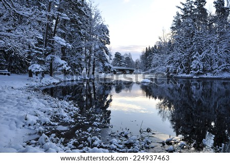 Scenic view of a wintry river before the sunrise - stock photo