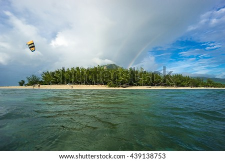 scenic view of kites, clouds, huge rainbow and scenic mountains. Mauritius, Indian ocean - stock photo