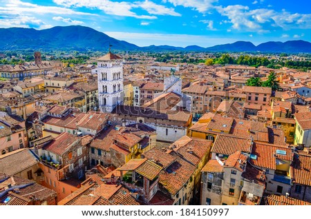 Scenic view of Lucca colorful village from Torre delle Ore, Lucca, Italy - stock photo