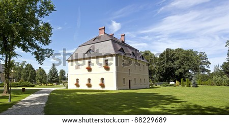 Scenic view of manor house on countryside estate, Poland. - stock photo