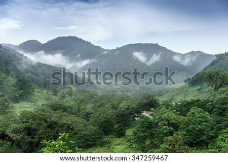 Scenic view of mountains in foggy weather, Costa Rica - stock photo