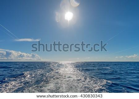 Scenic view of ocean, horizon and beautiful sky - stock photo