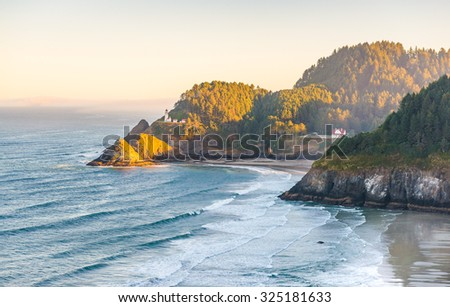 scenic view of Oregon coast beach in the morning. - stock photo