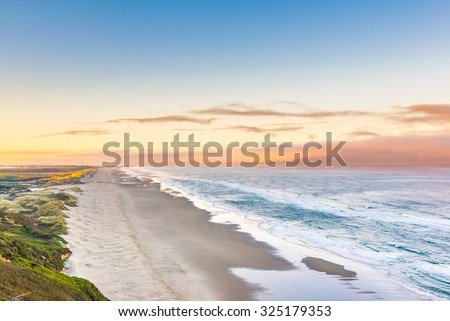 scenic view of Oregon coast in the morning with the moon. - stock photo