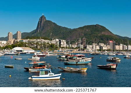 Scenic View of Rio de Janeiro City and Corcovado Mountain with Christ the Redeemer, Boats in the Harbor and Hills. - stock photo