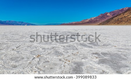 Scenic view of salt planes. The bottom of the dried-up salt sea. The bark of salt. Badwater Salt Flat, Death Valley National Park - stock photo