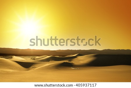 scenic view of sand dunes at sunset - stock photo