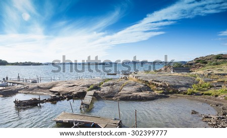 Scenic view of small wharf in western part of sweden. - stock photo