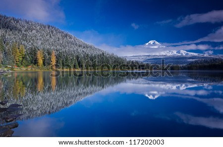 Scenic view of snow capped mountain and its reflection in lake in foreground. Mount Hood and Trillium Lake after fresh snowfall. - stock photo