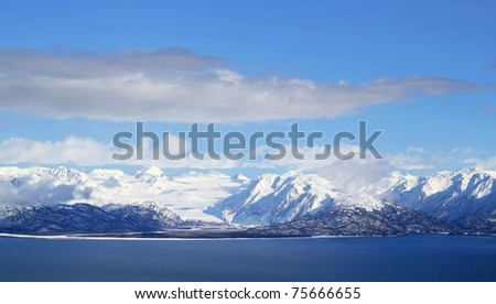 Scenic view of snow covered glaciers across the Kachemak Bay from Homer Alaska - stock photo