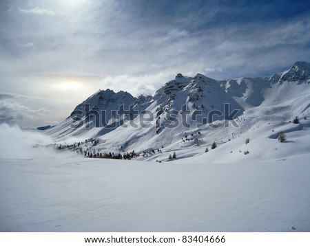 Scenic view of snow covered mountains in skiing area of Vars, France. - stock photo