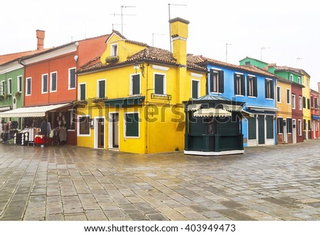 Scenic view  of square with colored houses in the Burano island. Venetian lagoon. Italy. Travel (vacation), architecture concept. Copy space. - stock photo