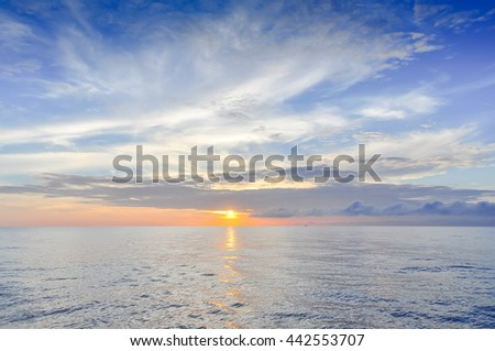 Scenic view of sunrise with colorful dramatic sky cloud above the sea in Khanh Hoa province. Early morning seascape, sunrise on the beach at the central coast of Vietnam. Nature background vintage. - stock photo