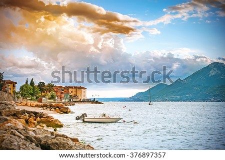 Scenic view of sunset at Lake Garda in the evening, Veneto, Italy - stock photo