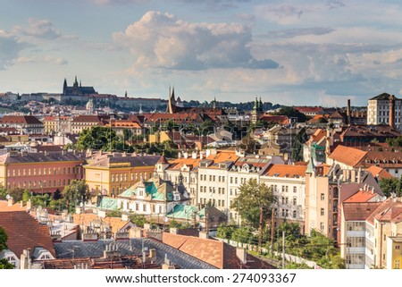 Scenic view of the historical center of Prague: houses, buildings, palaces, landmarks of old town with the characteristic and picturesque red rooftops and multi-coloured walls. - stock photo