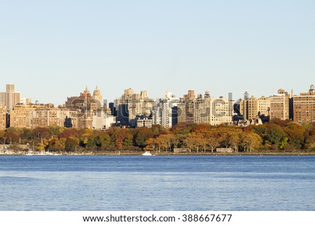 Scenic view of the New York Manhattan skyline seen from across the Hudson River in Edgewater, New Jersey. - stock photo