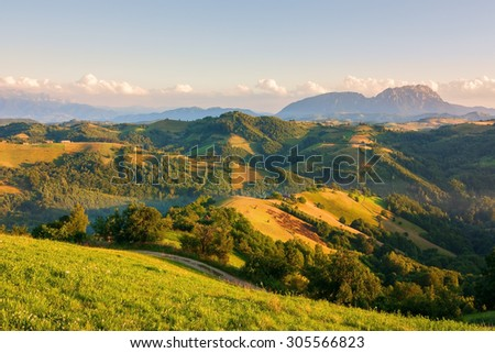 Scenic view of valley with beautiful mountains in the background - stock photo