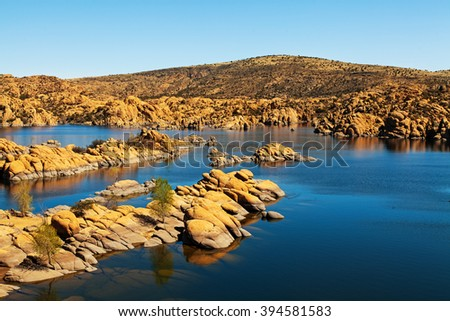 Scenic view of Watson Lake in Prescott, AZ, USA surrounded by majestic large red rock boulders and mountains - stock photo