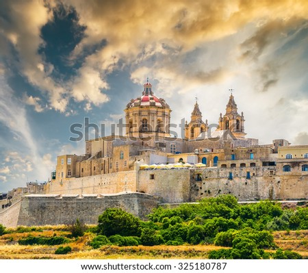 scenic view on historical town of Mdina in Malta at sunset - stock photo
