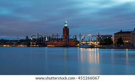 """Scenic """"white night"""" view of the City Hall in the Old Town (Gamla Stan) in Stockholm, Sweden - stock photo"""