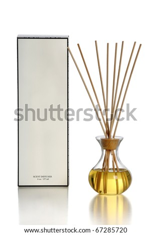 Scent diffuser over white background with reflections on table - stock photo