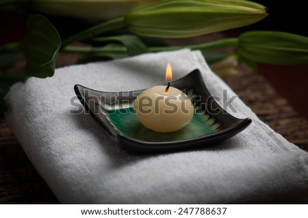 Scented candle burning in a spa. - stock photo