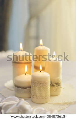 Scented candles on a wedding decoration - stock photo