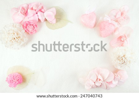 Scented potpourri flowers and leaves with two glittery pink Valentine's Day hearts on handmade paper background.  - stock photo
