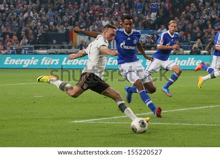 SCHALKE, GERMANY - SEP 21: Franck Ribery (FC Bayern) and Joel Matip (Schalke 04) during a Bundesliga match between FC Schalke 04 & FC Bayern Munich on September 21, 2013, in Schalke, Germany. - stock photo