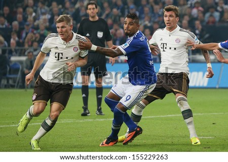 SCHALKE, GERMANY - SEP 21: Schweinsteiger & Mandzukic (Bayern) vs. Kevin-Prince Boateng (Schalke) during a match between FC Schalke 04 & FC Bayern Munich on September 21, 2013, in Schalke, Germany. - stock photo