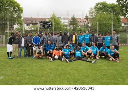Scharnhausen, Germany - May 14, 2016: Happy group photo after the team of TSV Scharnhausen was playing a friendly match of soccer against a team of refugees that is residing in a camp in Scharnhausen - stock photo
