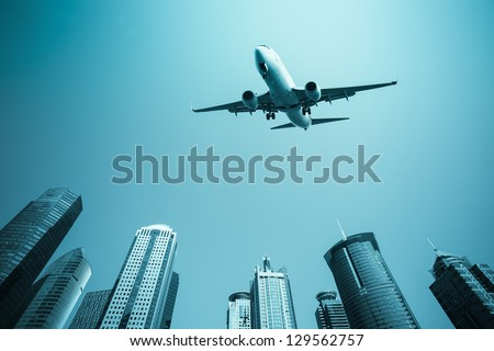 scheduled flight with modern buildings skyline in shanghai - stock photo