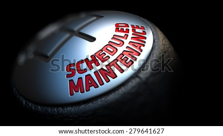 Scheduled Maintenance - Red Text on Black Gear Shifter with Leather Cover. Close Up View. Selective Focus. - stock photo