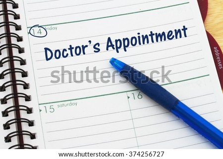 Scheduling your doctor's appointment, a day planner with blue pen with text Doctor's Appointment - stock photo